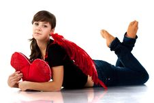 Beautiful Girl Lying With Heart Shaped Red Pillow Royalty Free Stock Images