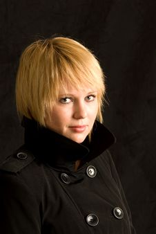 Free Blond Woman And Black Trench Coat Stock Photography - 17631332
