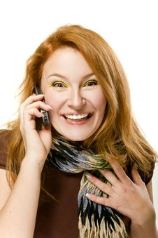 Red-haired Woman Emotionally Talking On Phone Royalty Free Stock Photos