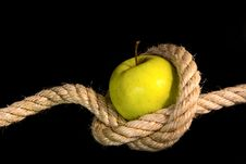 Free Green Apple Tided With Rope Stock Photo - 17636070