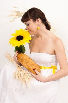 Free Girl With Bread, Sunflower And Ears Of Wheat Stock Photo - 17636840
