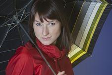 Woman Holding An Umbrella Stock Photo