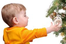 Free The Child And A Fur-tree Toy Stock Photography - 17638332
