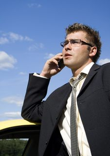 Businessman Talking On Mobile Phone Royalty Free Stock Image