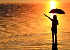 Free Silhouette Of Young Woman Against Summer Sunset Stock Photo - 17640870