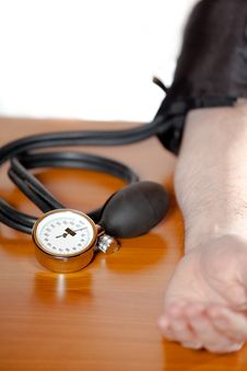 Blood Pressure Gauge At Man`s Arm Stock Photography