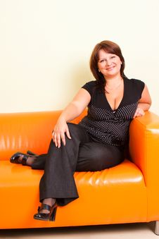 Free Young Woman On A Leather   Sofa Stock Photos - 17641643