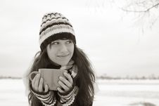 Free The Girl Smiles And Holding A Cup Stock Photography - 17643262