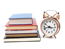 Back To School Concept With Books And Clock Royalty Free Stock Images