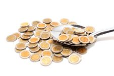 A Spoon Full Of Coins Royalty Free Stock Photos