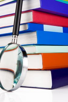Free Books And Magnifier Isolated On White Royalty Free Stock Photos - 17647788