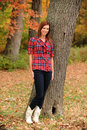 Free Young Woman Standing By A Tree Royalty Free Stock Photography - 17653887