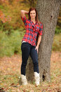 Free Young Woman Standing By A Tree Stock Photo - 17653890