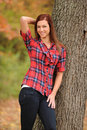 Free Young Woman Standing By A Tree Stock Images - 17653914