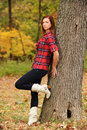 Free Young Woman Standing By A Tree Stock Photo - 17653920