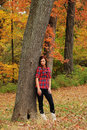 Free Young Woman Standing By A Tree Royalty Free Stock Image - 17654006