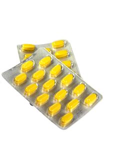 Yellow Pills In Blister Isolated Stock Photography