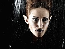 Vampire Woman Behind Rainy Window Royalty Free Stock Photos