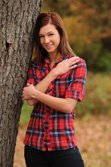 Free Young Woman Standing By A Tree Stock Images - 17653964