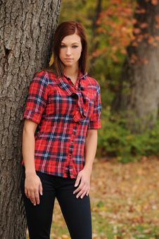 Free Young Woman Standing By A Tree Stock Photo - 17653970
