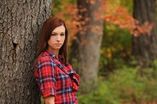 Free Young Woman Standing By A Tree Stock Photography - 17654002