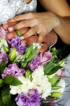 Free Wedding Rings Over Bouquet Stock Image - 17654011