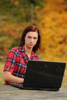 Young Woman With Laptop Computer Royalty Free Stock Photography