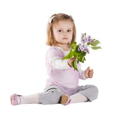 Free Little Girl Giving A Branch Of Lilac Stock Photos - 17655273