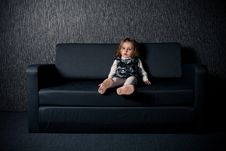 Free Little Girl Sitting On Sofa Stock Images - 17655774
