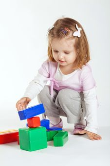 Little Girl Plays With Cubes Royalty Free Stock Photo