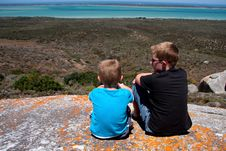 Brothers On Vacation At Coast Enjoying The View Royalty Free Stock Photo