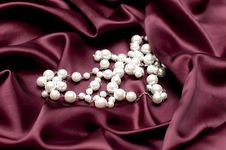 Free Pearls On Ruby Satin Royalty Free Stock Images - 17659709