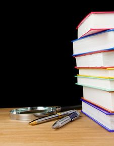 Free Pile Of Books And Pen On Black Royalty Free Stock Image - 17662206
