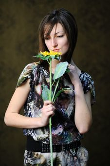 Woman With Yellow Flower Royalty Free Stock Images