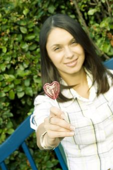 Free Girl With A Lollipop In The Shape Of A Heart Stock Photo - 17663330