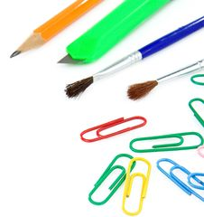 Paintbrush, Paper Clips And Pencil On White Royalty Free Stock Photo