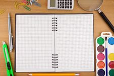 Free School Accessories And Checked Notebook On Wood Royalty Free Stock Image - 17664396