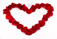 Heart Made From Red Petals Royalty Free Stock Photos