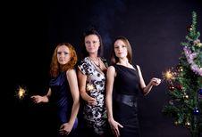 Three Girls And Christmas Tree Stock Image