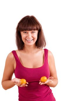Young Woman - Gorgeous Breast And Small Mandarines Stock Photography