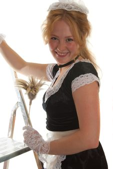 Free Smiling Maid With A Feather Duster Royalty Free Stock Photography - 17669277