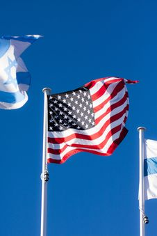Free American Flag On Blue Sky Stock Image - 17675541