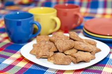 Cookies With Cups And Saucers Royalty Free Stock Image