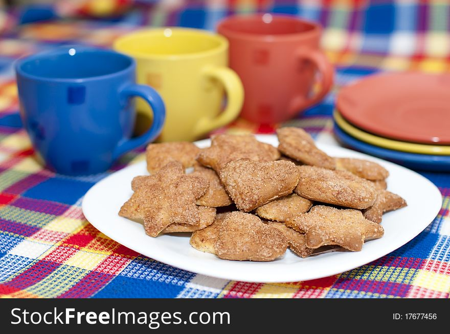 Cookies with cups and saucers