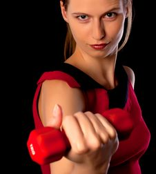 Free Serious Woman Athlete Showing Dumbbell Stock Photo - 17682280