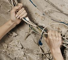 Free Woman Hands Grabbing Wires To Tear It Royalty Free Stock Images - 17682349