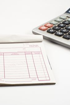 Free Cashier Book And A Calculator Stock Photo - 17683630