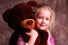 Young Girl And Her Bear Stock Photo