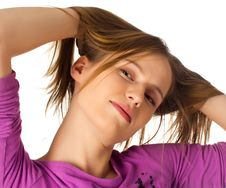 Pretty Young Female Playing With Her Hair Stock Photography