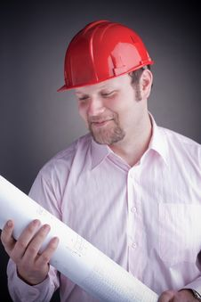 Free Young Attractive Engineer With Blueprints Stock Photography - 17686402